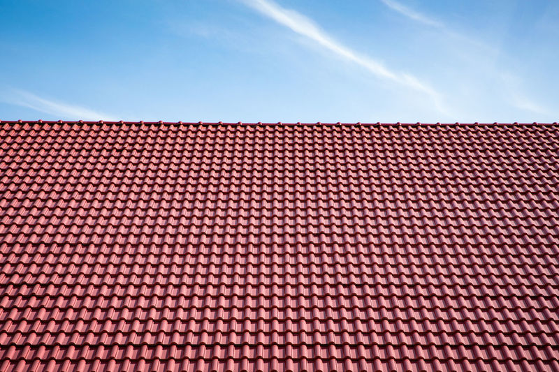 Red tiles roof on blue sky