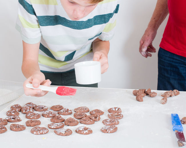 People Making Cookies On Table At Home