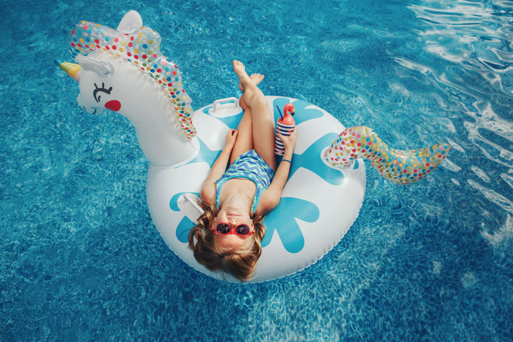 High angle view of girl swimming in pool