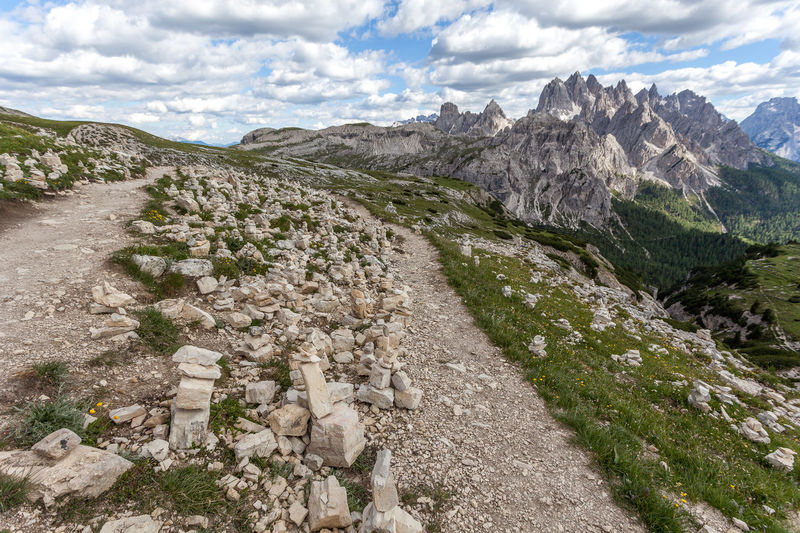 Spectacular path at the foots of Tre Cime di Lavaredo, Dolomites, Italy Dolomites Dolomiti Unesco Veneto Adventure Alpine Alps Altitude Beautiful Beauty Blue Cairns Clouds Dolomite Europe Flowers High Hiking Italy Landscape Light Meadow Mountain Mountains Nature Outdoor Panorama Park Peak People Pinnacles Range Rock Rocky Scene Scenery Scenic Sky Stone Summer Summit Sunny Top Tourism Travel Tre Cime Di Lavaredo Trekking Vacation View