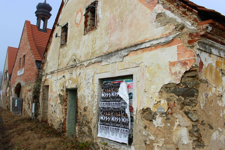 The old abandoned house with the current Kiss posters Abandoned Bad Condition Band Brick Wall Building Building Exterior Contrast Czech Republic Damaged Deterioration House Kiss Kissband Obsolete Old Poster Ruined Travel Traveling Weathered