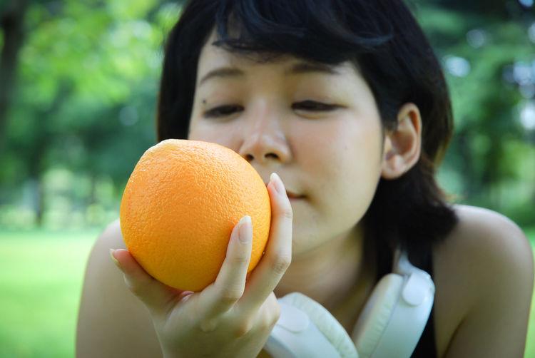 Close-up portrait of baby girl holding ice cream