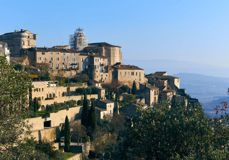 View to the Gordes, is a very beautiful hilltop village in France. Provence-Alpes-Cote d'Azur region Ancient Architecture Architecture Avignon Blue Sky Buildings Europe France French Gordes Hillside Hilltop Landmark Landscape Nature Old Outdoors Picturesque Village Provence-Alpes-Cote D'Azur Skyline South Town Travel Destinations Trees Vaucluse Village