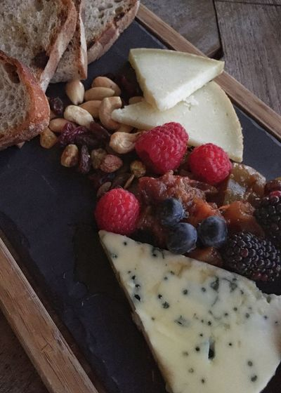 Rustic looking cheese board. Food Vertical Hard Cheese Bread Nuts Blackberry Raspberry Gorgonzola Blue Cheese Cheese Cheese Board Food Food And Drink Berry Fruit Fruit Healthy Eating Freshness Still Life High Angle View Indoors  No People Wellbeing Sweet Food Close-up Indulgence Table Temptation Directly Above Sweet Ready-to-eat