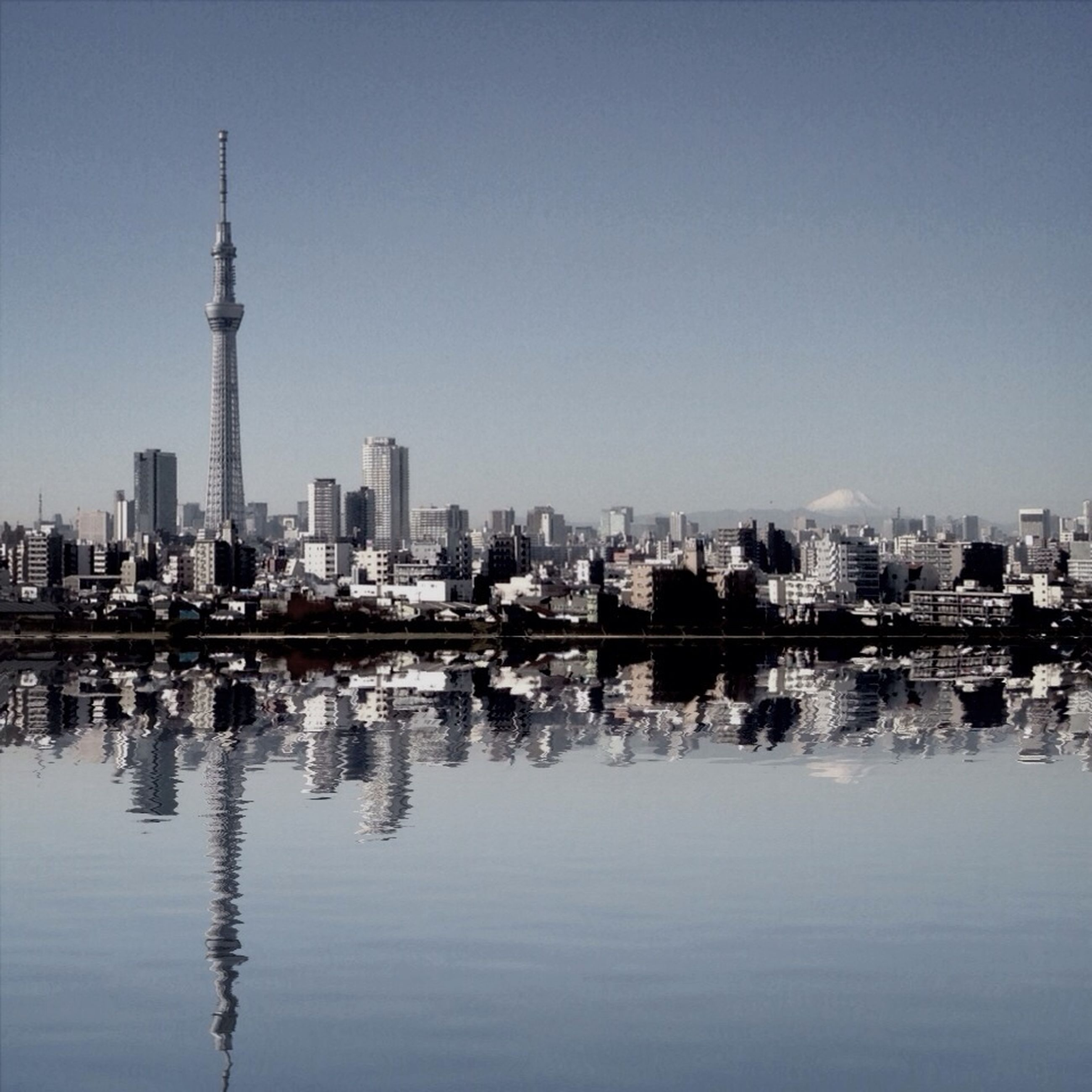 building exterior, architecture, city, built structure, skyscraper, water, cityscape, waterfront, urban skyline, tall - high, reflection, tower, river, clear sky, modern, office building, skyline, financial district, capital cities, copy space
