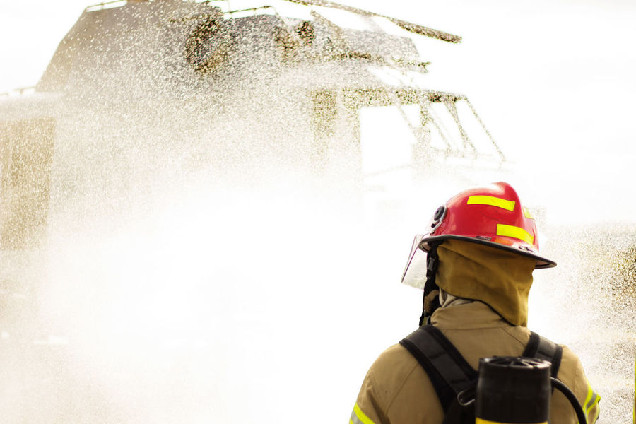 Some firemen doing some training with real fire. Business Extinguishing Fires Firefighter Hot RISK Risky Business Teamwork Extinguishing Fire Firemen Firemen At Work Oxygen Sweat Training Water