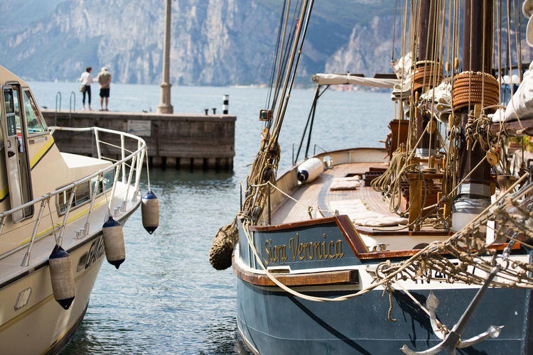 Blue Lagoon Blue Water Boat Casual Clothing Duck Italy Jetty Lake Garda Landscape Mast Mountains Rocks Rope Sail Siora Veronica Sunshine Swans Water