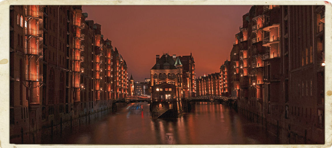 View of illuminated buildings at sunset