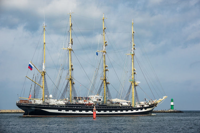 Windjammer in Warnemuende, Germany. Baltic Sea Hanse Sail HanseSail Lighthouse Rostock Sailing Ship Tall Ship Travel Warnemünde Cloud - Sky Coast Day Journey Mode Of Transport Mole Nature Nautical Vessel No People Outdoors Shore Sky Tourism Vacation Water Windjammer