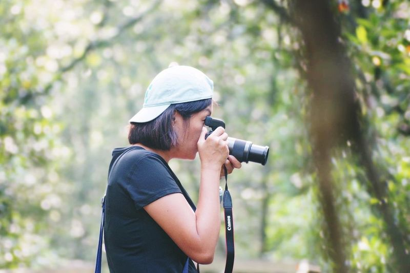 Eyeem Singapore EyeEm Selects Photography Themes Camera - Photographic Equipment One Person Technology Tree Photographing Leisure Activity Side View Day Real People Lifestyles Activity Holding Casual Clothing Photographer