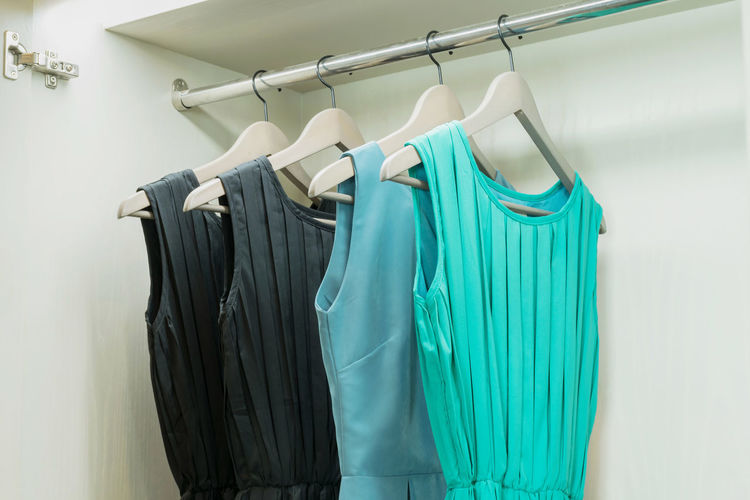 Dresses hanging on rack in store