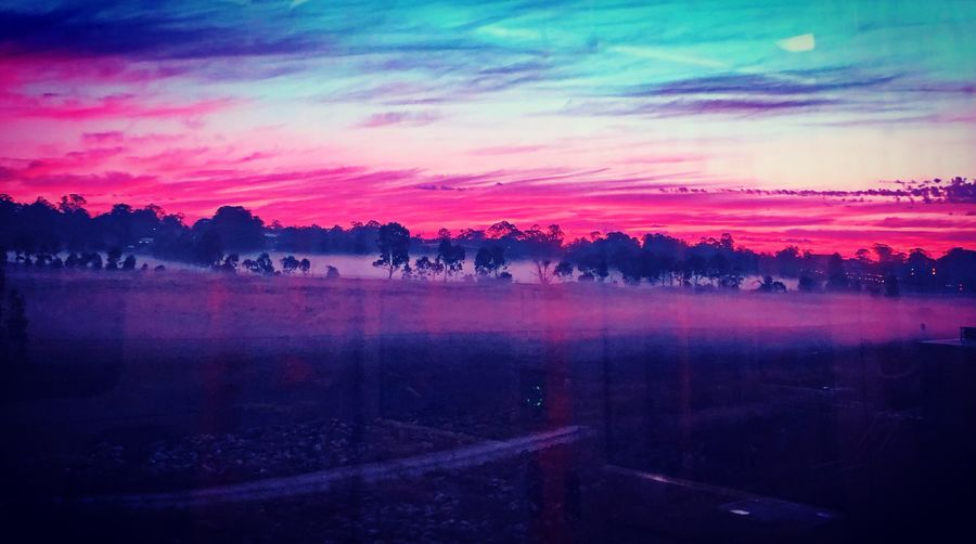 Colourful sunrise Outdoors EyeEm Picoftheday Photooftheday EyeEm Gallery Photography Sky Cloud - Sky Beauty In Nature Scenics - Nature Tranquil Scene Tree Nature Water No People Tranquility Sunset Pink Color Plant Environment Landscape Idyllic Multi Colored Outdoors Lake Purple