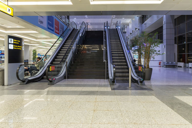 Belgrade, Serbia, May 05, 2019 : Escalator leading to the upper floor in the check-in lounge at the Nikola Tesla International Airport near the city of Belgrade in Serbia Sky And Clouds Floor Escalators And Staircases Nikola Tesla International Airport Waiting Trip Traveler Travel Transportation Tourist Tourism Terminal Serbia Scoreboard Plane People Passenger Monitors Modern Luggage Lines Journey Interior Inside Information Indore Indoor Hall Group Flight Europe Equipment Design Departure Crowd Counter Check-in Business Building Belgrade Baggage Aviator Aviation Arrival Architecture Airserbia Airplane Airline Aircraft