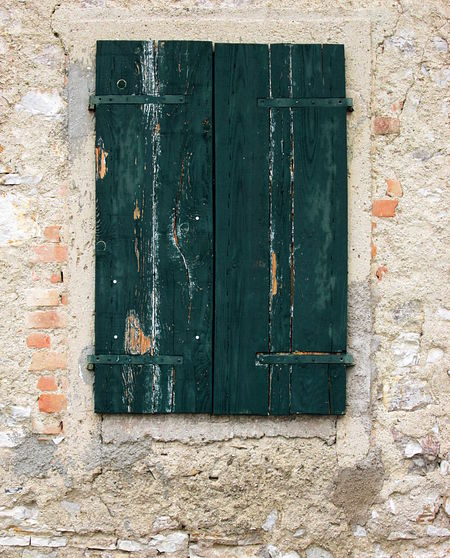 Close-up of Green Weathered Wooden Window 2016 Abandoned Bad Condition Close-up Closed Damaged Day Deterioration Green No People Obsolete Old Old Wall Protection Rusty Safety Scratched And Cracked Wood Timber Weathered Weathered Window
