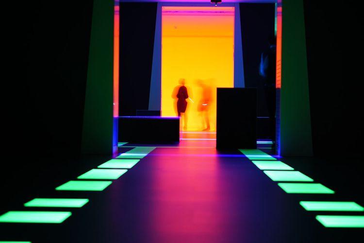 Rear view of man at illuminated entrance