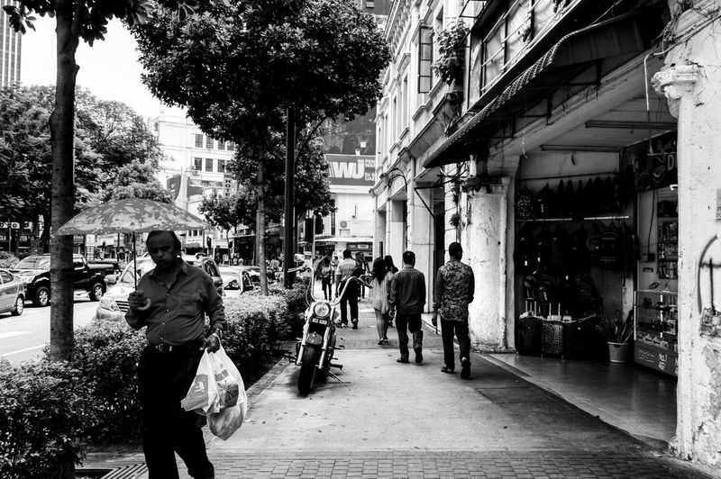 """""""Monochrome in Petaling"""" Street Walking City Building Exterior Real People Day Men Large Group Of People Outdoors People First Eyeem Photo EyeEmNewHere"""