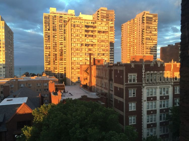 Taking pictures out my living room windows at Lake Michigan and the evening sun is leaving amazing colors onto the sky and buildings. Pspauly63 Sunset Lake View Chicago