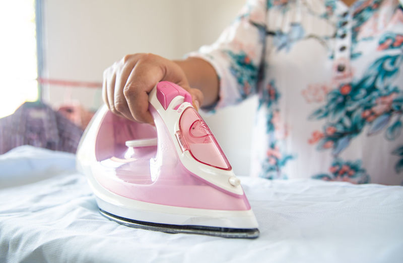 One Person Bed Indoors  Bedroom Focus On Foreground Pink Color Furniture Women Adult Shoe Lifestyles Domestic Room Human Body Part Midsection Day Clothing Close-up Textile Hand Floral Pattern