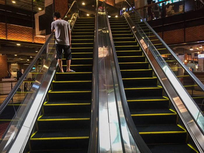 Man stand alone on escalator in shopping mall Thailand Leisure Asian  Wall - Building Feature Business Market Marketplace Shopping Mall Shopping Center Escalator Staircase Architecture Steps And Staircases Full Length Railing Built Structure Walking Men Adult Indoors  City Direction Lifestyles City Life People The Way Forward Moving Up The Street Photographer - 2019 EyeEm Awards