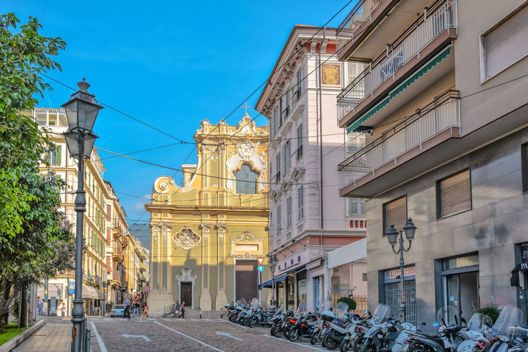 Architecture City City Life Motorcycle Scooter Sky And Clouds Tree Architecture Building Building Exterior Built Structure City Clear Sky Day Italy Outdoor Photography Outdoors Place Of Worship Real People Sky Street Street Photography Streetphotography Travel Destinations Tree