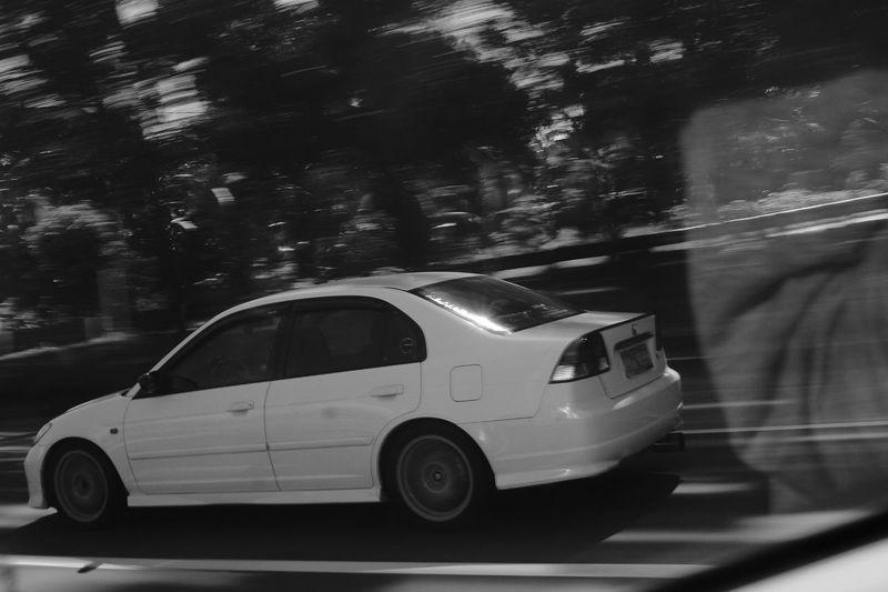 """speed reflection"" Speed Speeding Speeding Along Speeding Cars Cars EyeEm Best Shots - Black + White EyeEm Panningphotography Panning Panning Shoot Black & White Blackandwhite Black And White Motion Monochrome Car Transportation No People Outdoors"