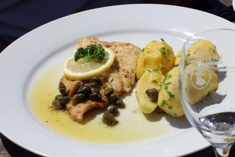 Close-up view of fresh salmon stake and potatoes