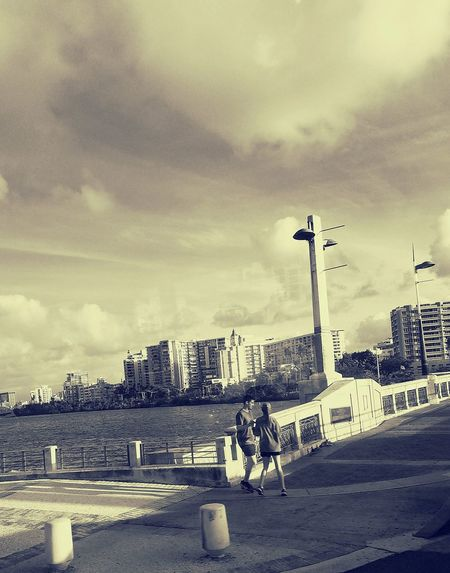 City Cityscape Architecture Cloud - Sky Sky Beach City Life Urban Skyline San Juan PR Perspective Popular Fashion Stories City Life Light And Shadow Couple Urban Exploration Skyscraper Casual Clothing An Eye For Travel Stories From The City Visual Creativity Focus On The Story Adventures In The City The Street Photographer - 2018 EyeEm Awards #urbanana: The Urban Playground