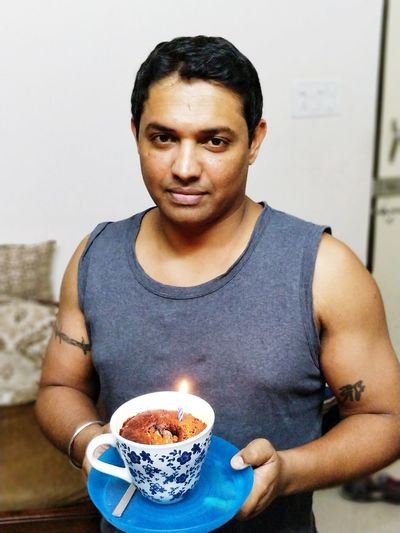 EyeEm Selects One Man Only Adults Only Portrait Burning Only Men Front View Waist Up Indoors  Adult Looking At Camera One Person Casual Clothing Mature Adult Flame People Heat - Temperature Food And Drink Healthy Lifestyle Lifestyles One Mature Man Only Happy Birthday! Love Yourself This Is Masculinity