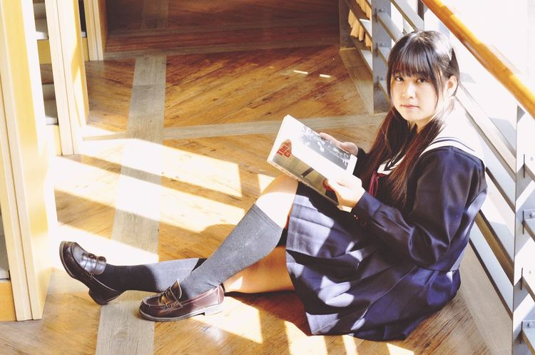 Encounters lovely schoolgirl Reading One Woman Only One Person Only Women Sitting Learning Indoors  Adults Only Full Length One Young Woman Only Education Adult Smiling Young Adult People Beautiful Woman Day Internet Library
