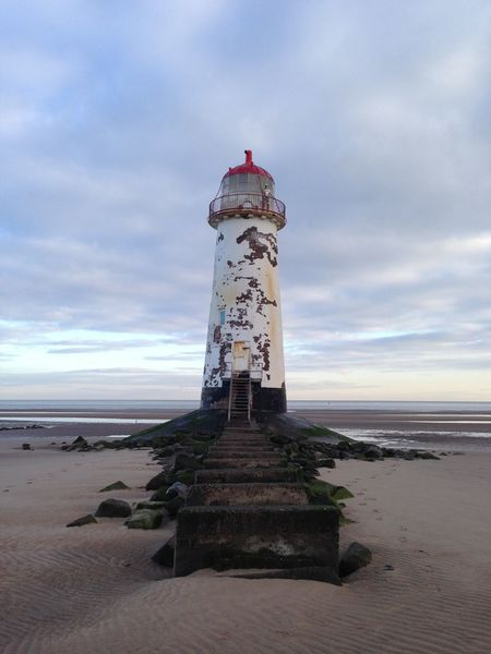 North Wales lighthouse haunted beach Guidance Direction Water Protection Sea Safety Built Structure Architecture Beach Tower Horizon Over Water Sky Tranquil Scene Sand Tranquility Shore Building Exterior Calm Coastline