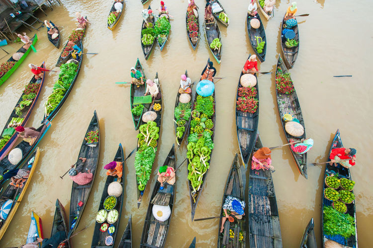 High Angle View Of People With Fruits In Boat Sailing On River
