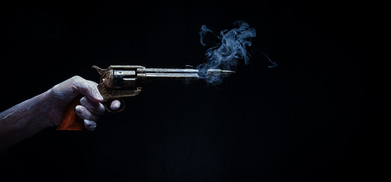 Revenge of the soiled dove Crime Dramatic Sky Gun Horizontal Lady Murder Shoot Smoke Wild West Aim Black Background Close-up Directly Above Dove Hand Holding Human Body Part Human Hand Intent Point And Shoot Saloon Shooting Smoking Gun Soiled Dove Western