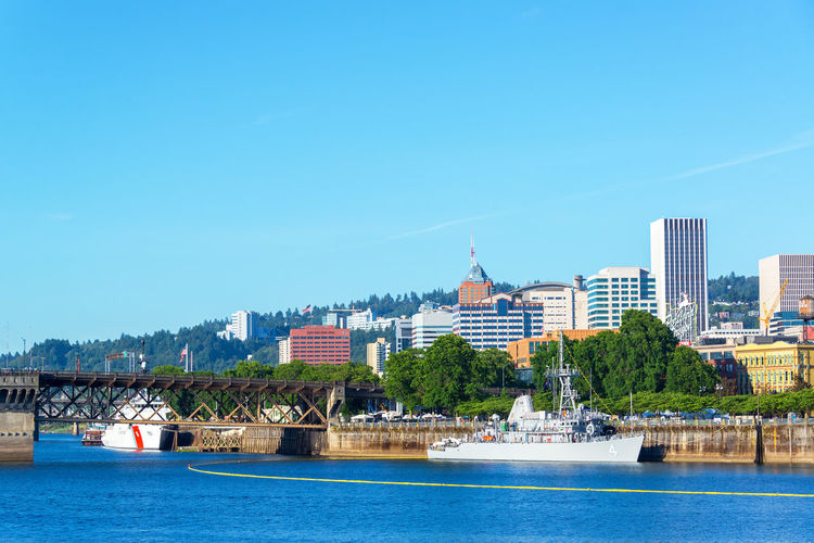 PORTLAND, OR - JUNE 7: Navy and Coast Guard ships on the waterfront of Portland, Oregon during the Rose Festival on June 7, 2015 Blue Boat Coast Guard Downtown Fleet Week Navy Oregon Portland River Rose Festival Royal Canadian Navy Ship Sky Tom Mccall Waterfront Park US Navy USA Warship Waterfront Willamette Willamette River