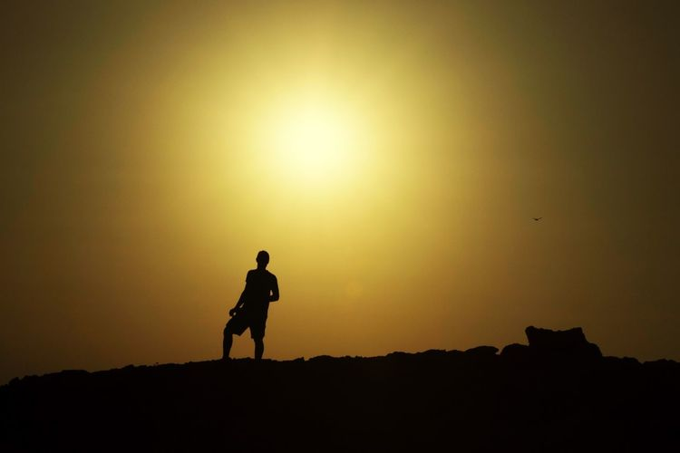 Silhouette Sunset Lifestyles Real People Leisure Activity Nature Men One Person Sky Day Sun Mountain Beauty In Nature