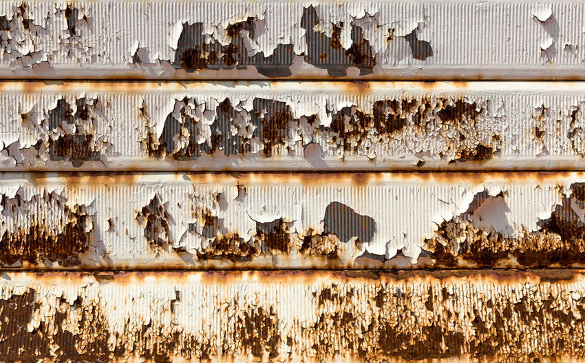 Rusty garage door. Vintage style. Ideal for backgrounds. Abandoned Abstract Aging Aging Process Background Brown Corroded Corrosion Dirty Door Garage Grunge Grungy Heavy Industrial Industry Iron Metal Metallic Old Olden Pattern Peel Retro Roll
