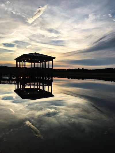 Water Sky Cloud - Sky Reflection Tranquility Beauty In Nature Scenics - Nature Tranquil Scene Nature No People Lake Architecture Silhouette Idyllic Waterfront Built Structure Sunset Hut Outdoors
