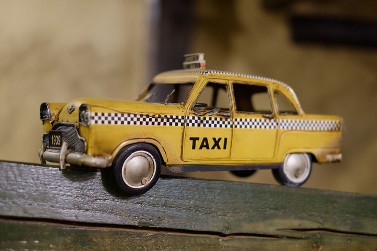 FUJIFILM X-T2 Japan Japan Photography Toy Taxi Cab Car Close-up Communication Day Fujifilm Fujifilm_xseries Land Vehicle Metal Protection Small Still Life Taxi Cab Tin Car Tin Toy Toy Transportation Western Script X-t2 Yellow Yellow Cab Yellow Taxi