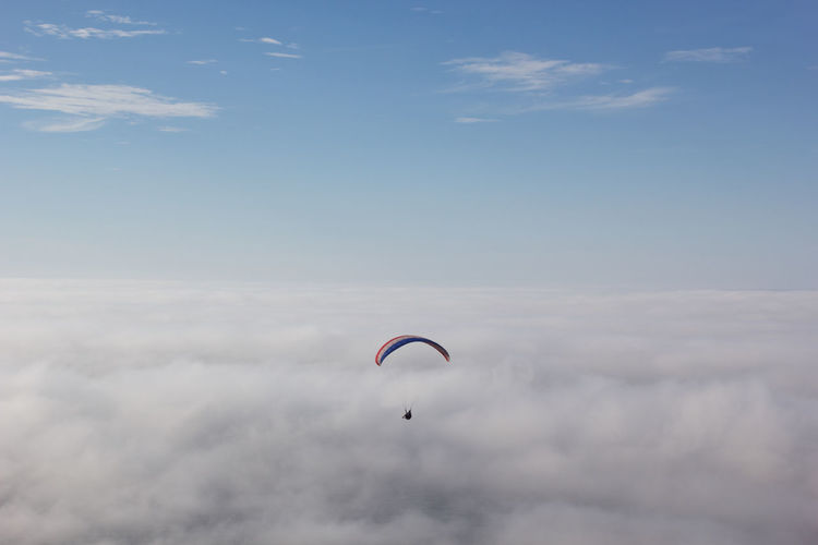 Parachute flying over cloudscape