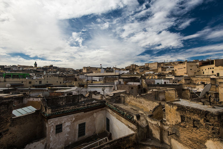 Afternoon view of the rooftops of Fez. Architecture Blue Building Building Exterior Built Structure City City Life Cityscape Cloud Cloud - Sky Cloudy Community Day Human Settlement Nature No People Outdoors Overcast Residential Building Residential District Residential Structure Sky Town TOWNSCAPE Weather