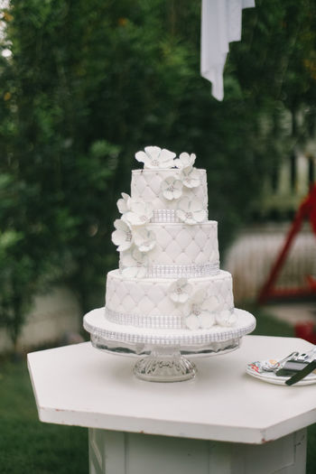 Close-up of weeding cake on table