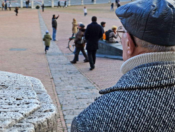 An elderly gentleman observes the child running across Piazza del Campo in Siena, Tuscany, Italy Real People Incidental People Men Focus On Foreground Leisure Activity Lifestyles People Adult Group Of People Warm Clothing Clothing Footpath Headshot Rear View Crowd Senior Adult Child Running Walkink Piazza Del Campo Siena Architecture Brick Wall Stone Ancient EyeEm Best Shots EyeEm Gallery EyeEmNewHere EyeEm Best Edits