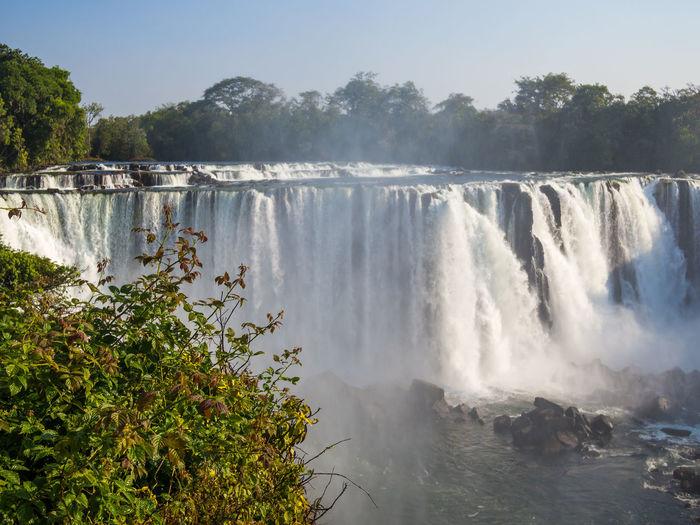 Scenic view of lumangwe waterfall against sky, zambia