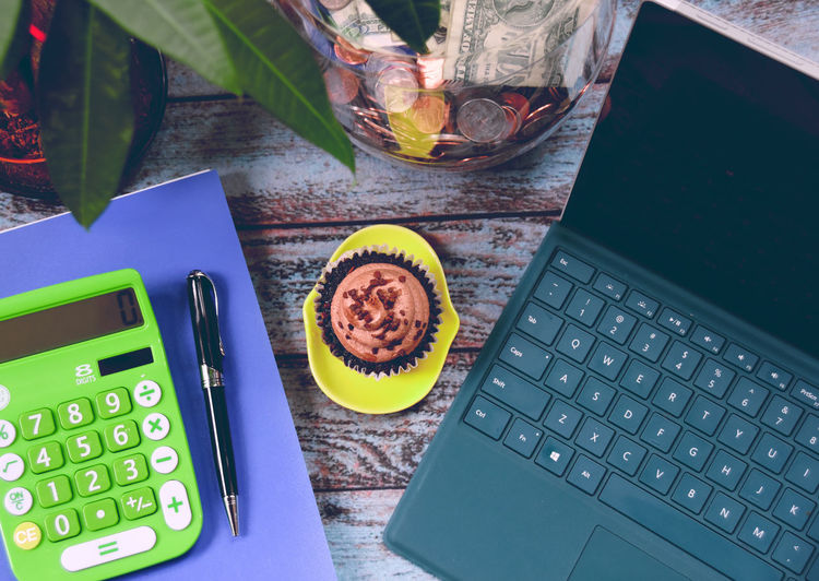 working space Rustic Blue Table Bussiness Close-up Communication Computer Computer Keyboard Cupcake Day Food And Drink Freshness Green Blue High Angle View Indoors  Keyboard Laptop No People Table Technology Wireless Technology Workspace