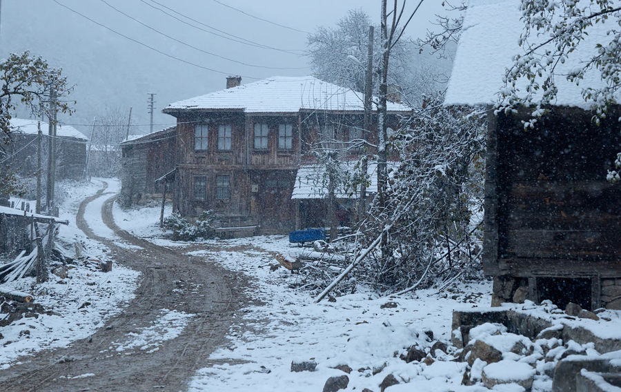 Snowy Village Life Beauty In Nature Building Exterior Cold Temperature Dirt Road Home Land Vehicle Muddy Nature Outdoors Snowflake Snowing Snowy Structure Sünnet Sünnetköy Transportation Turkey View Village Life Weather Winding Road Winter
