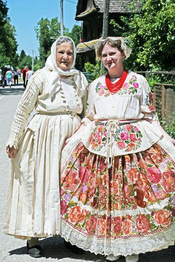 Ladies wearing national dress,Cigoc,village of storks,2,Croatia,EU Cigoc Clothes Croatia Culture Eu Ladies National Dress Portrait Tourism Traditional Village Of Storks