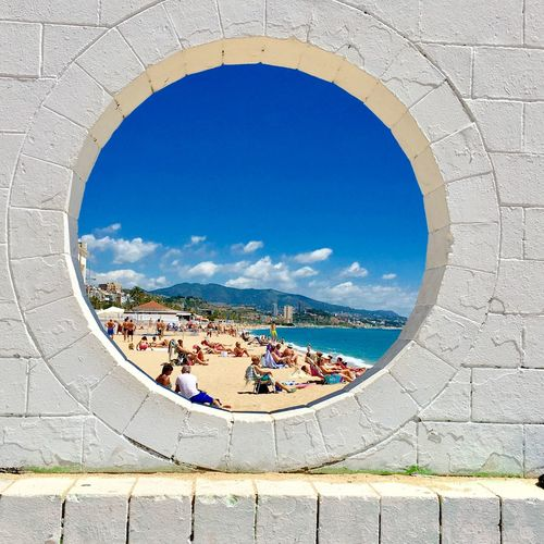 Badalona Rosafrancomendoza Day Arch Architecture Sky Built Structure Real People Leisure Activity Blue Water Outdoors People Large Group Of People Nature Lifestyles 10