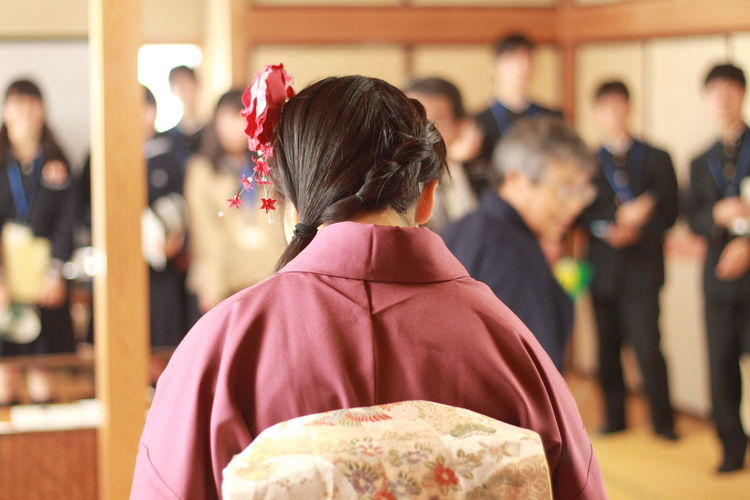 Rear View Of Woman At Tea Ceremony Indoors