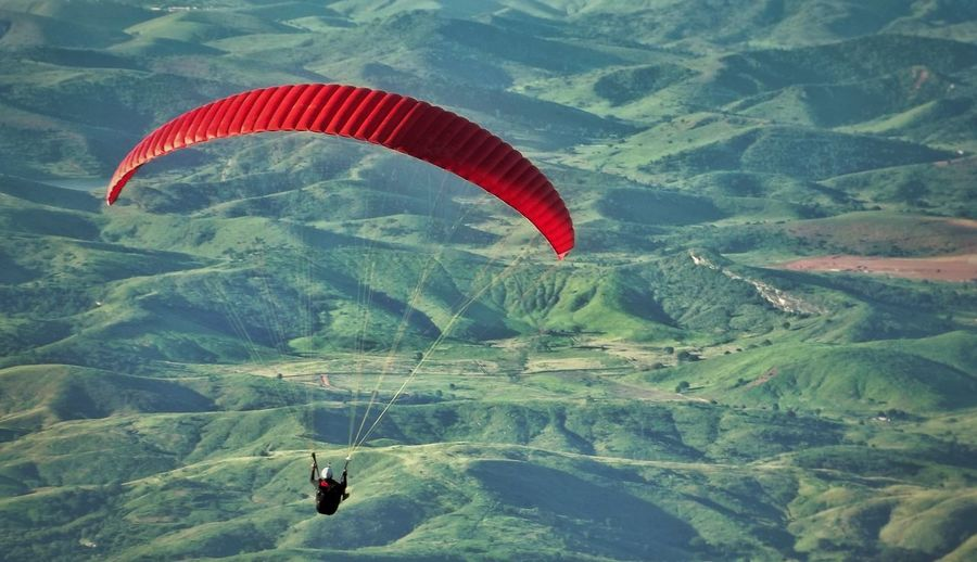 Extreme Sports Adventure Parachute Paragliding Flying Exhilaration Freedom Sport Leisure Activity Landscape Day RISK Scenics Outdoors Excitement Mountain One Person People Full Length Skydiving