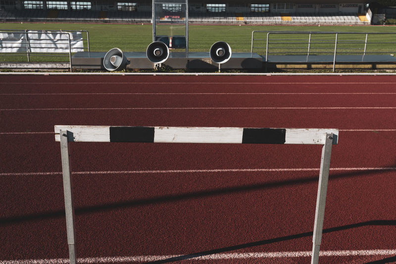 running track hurdle and speakers Tartan Track Athletics Sport Running Stadium Competition Speed Lanes Hurdle Hedge Obstacles Wooden Running Track Track And Field Sports Track Absence High Angle View Competitive Sport Playing Field Grass Outdoors No People
