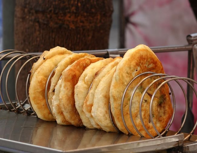 Fried onion pancakes are a popular Chinese snack Chinese Food Chives Crisp Fried Food Oily Onion Pancakes Street Food Streetfood